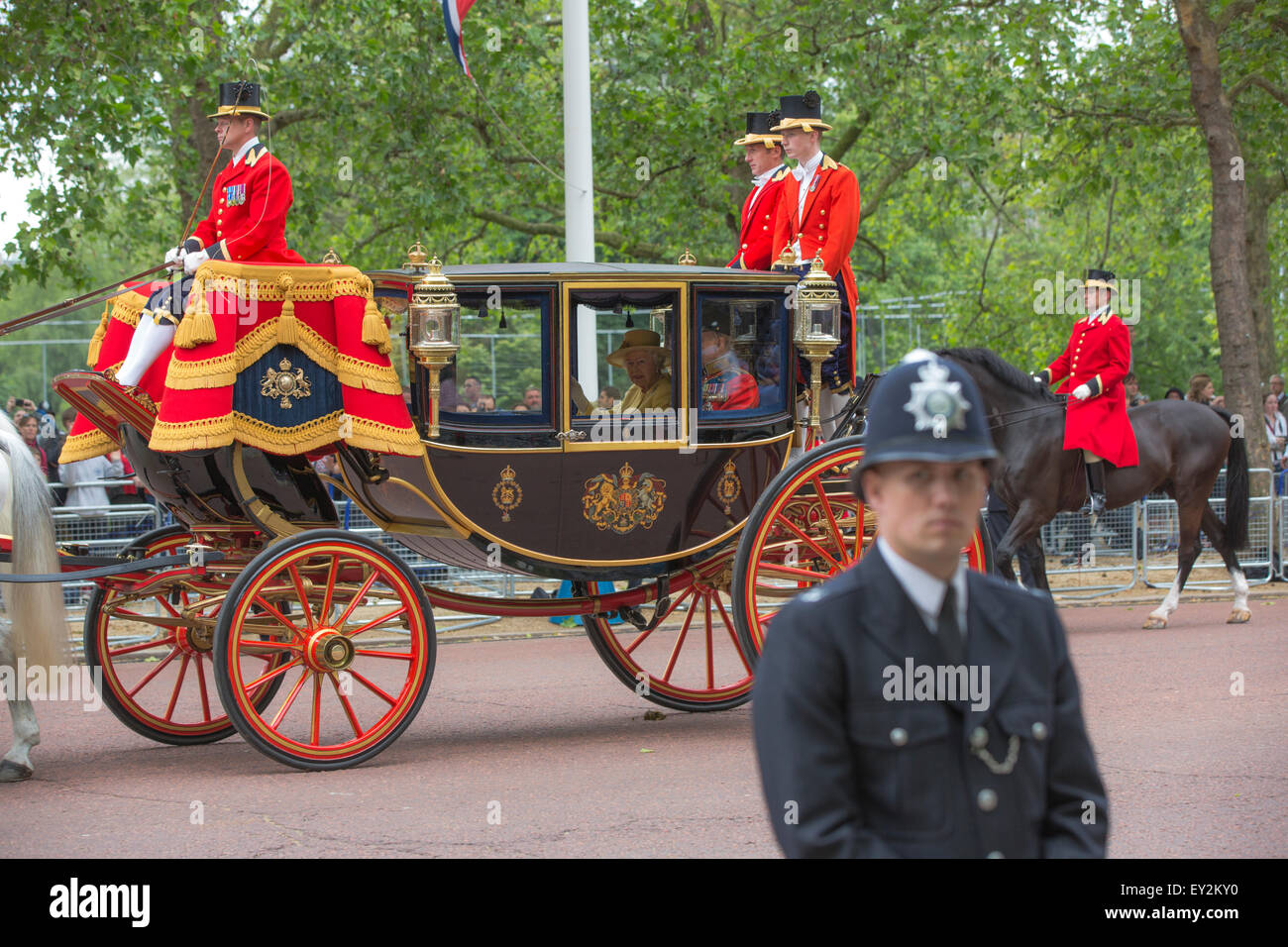 Queen Elizabeth II and Prince Phillip in the royal carriage on the Mall en route to the Trooping the Colours ceremony. - Stock Image