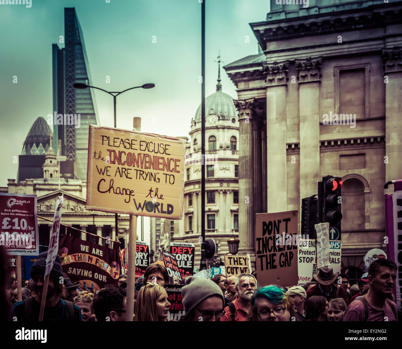 Anti-austerity march in the City of London on 20th June 2015 with landmark city buildings in the background - Stock Image