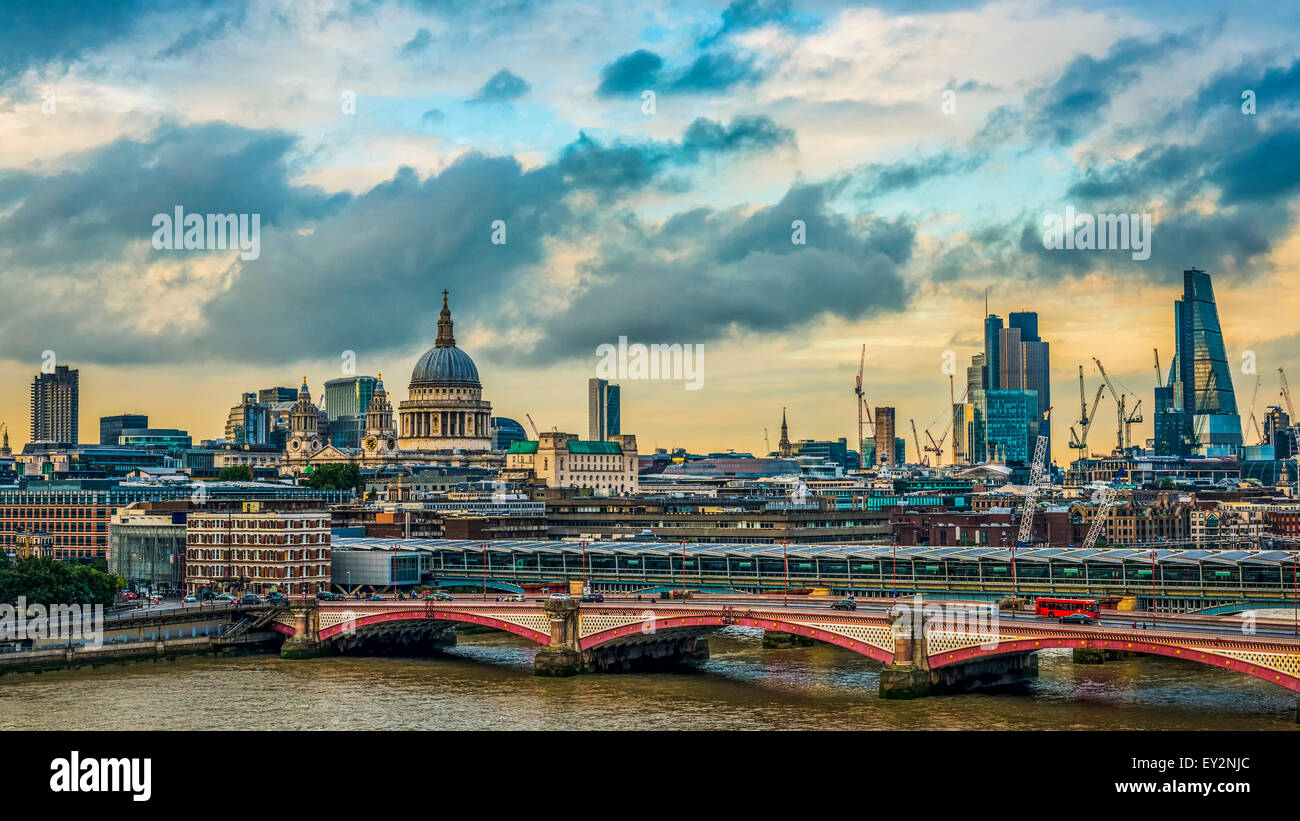 London skyline on a stormy day with the historical landmarks of St Paul's Cathedral, Blackfriars Bridge and the Stock Photo