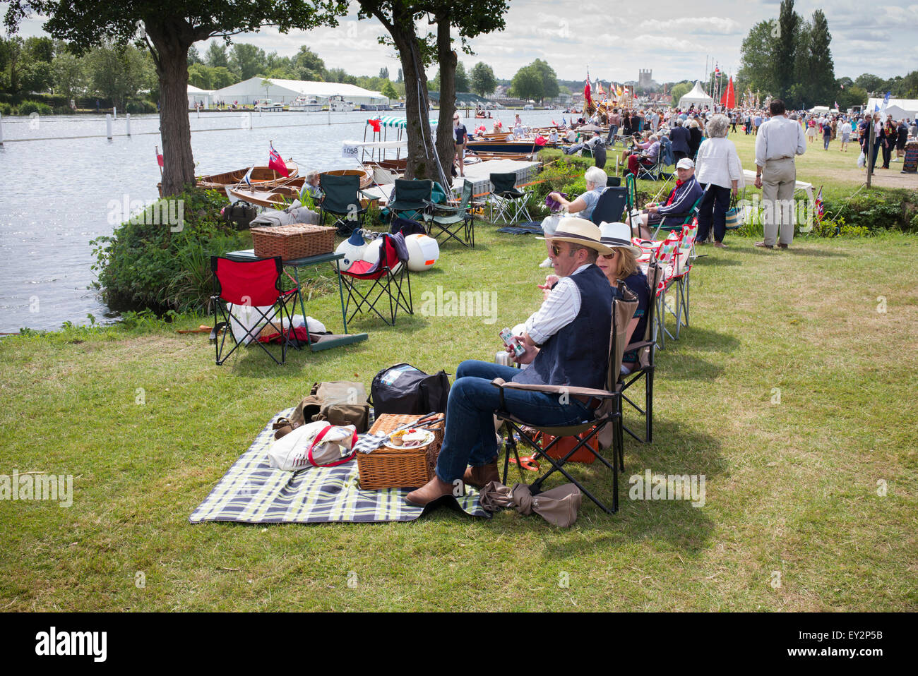 People picnicking at the Thames Traditional Boat Festival, Fawley Meadows, Henley On Thames, Oxfordshire, England - Stock Image