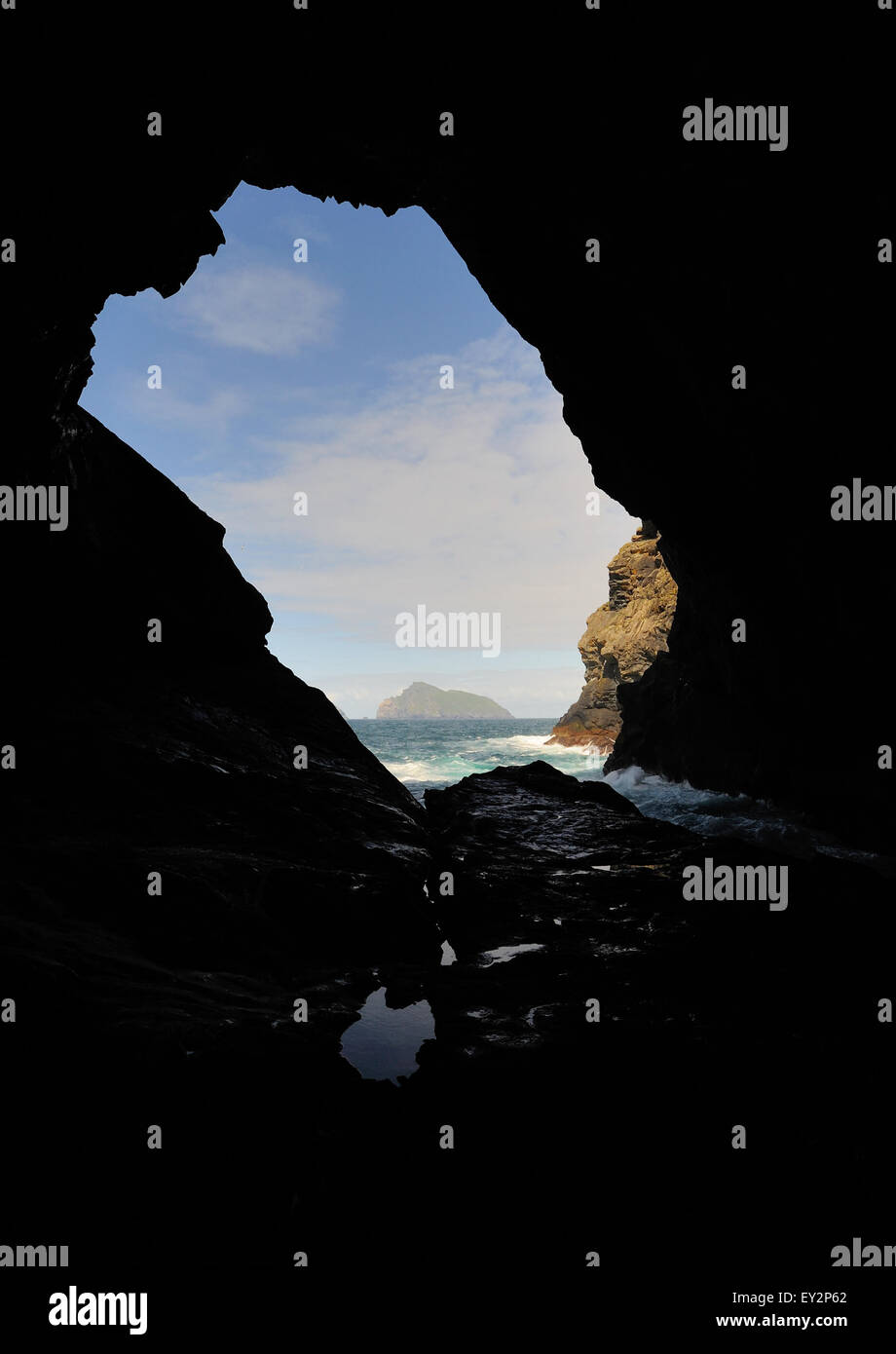 The island of Boreray  viewed through a sea cave on the northern end of Hirta. Hirta, St Kilda, - Stock Image