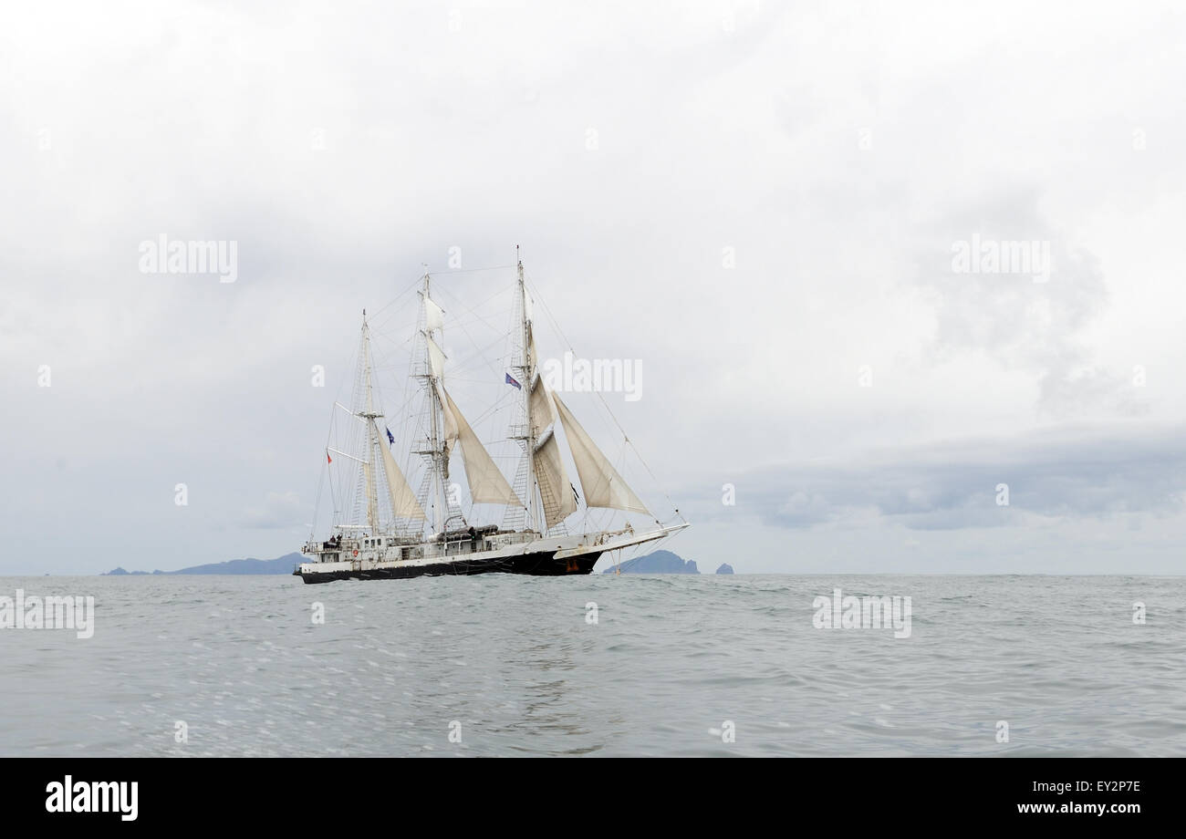 The barque rigged square rigger Lord Nelson Sails close to St Kilda. The islands of Dun, Hirta and Boreray can be - Stock Image