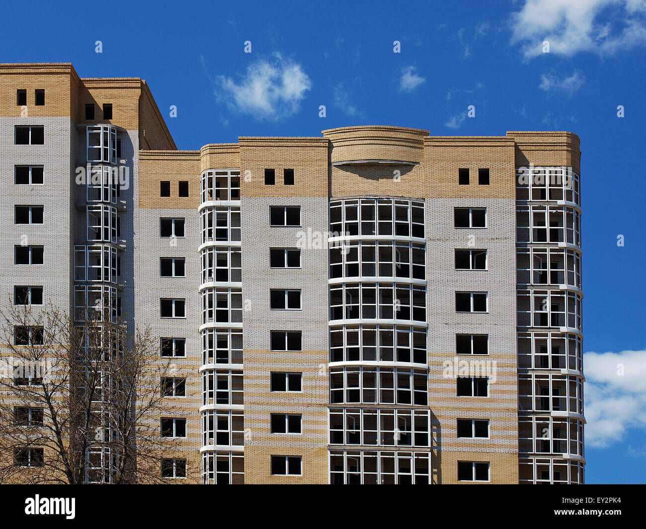The complex of multistory building against the blue sky without clouds - Stock Image