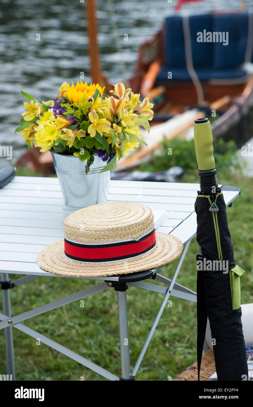 Straw boater hat umbrella and flowers at the Thames Traditional Boat Festival, Fawley Meadows, Henley On Thames, - Stock Image