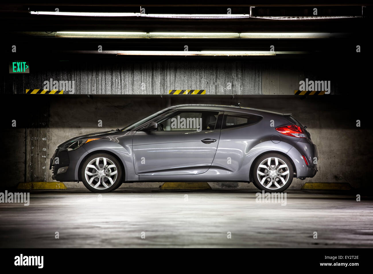Hyundai veloster parked at night in a multi story garage under