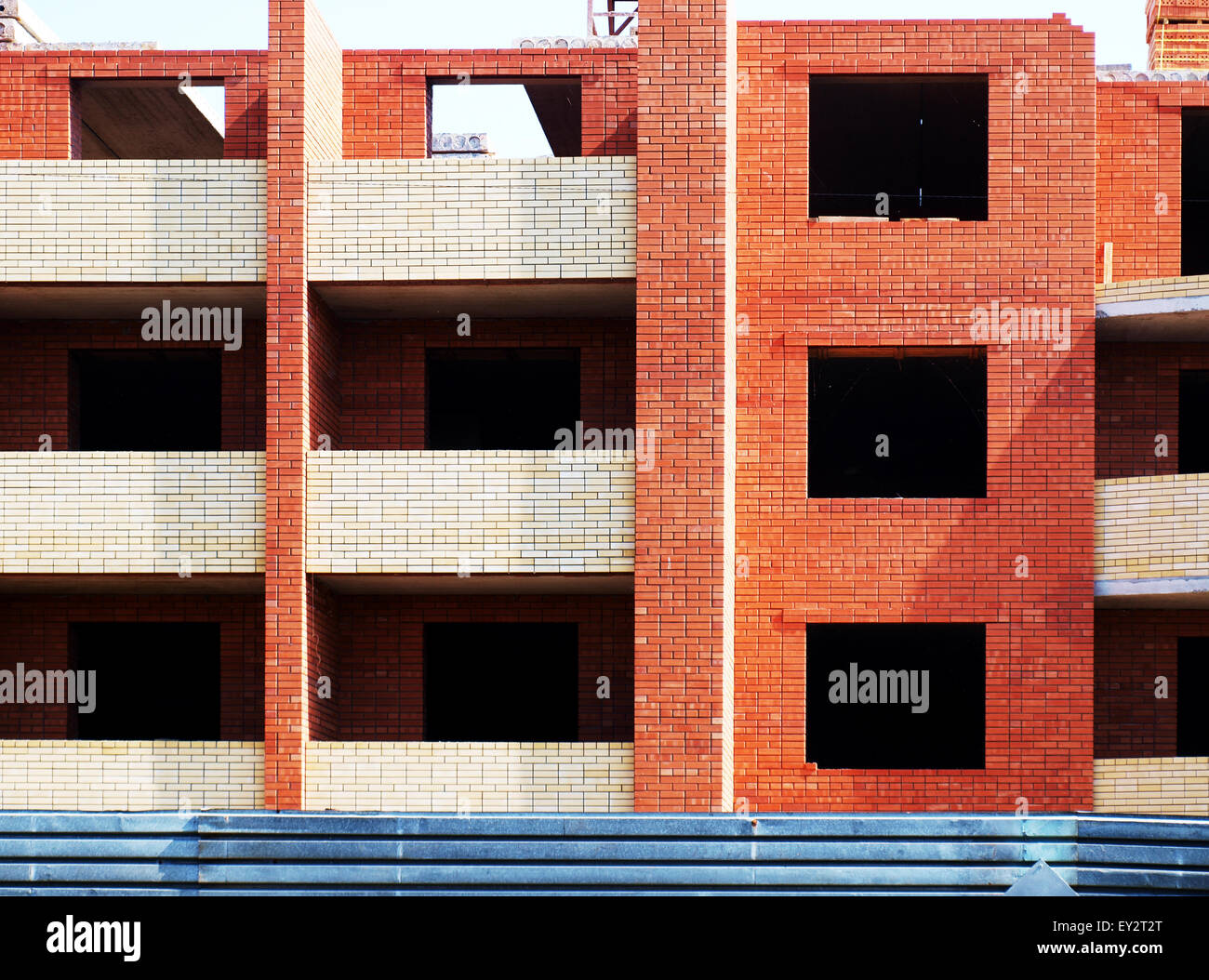 Multistory building from brick under construction closeup - Stock Image