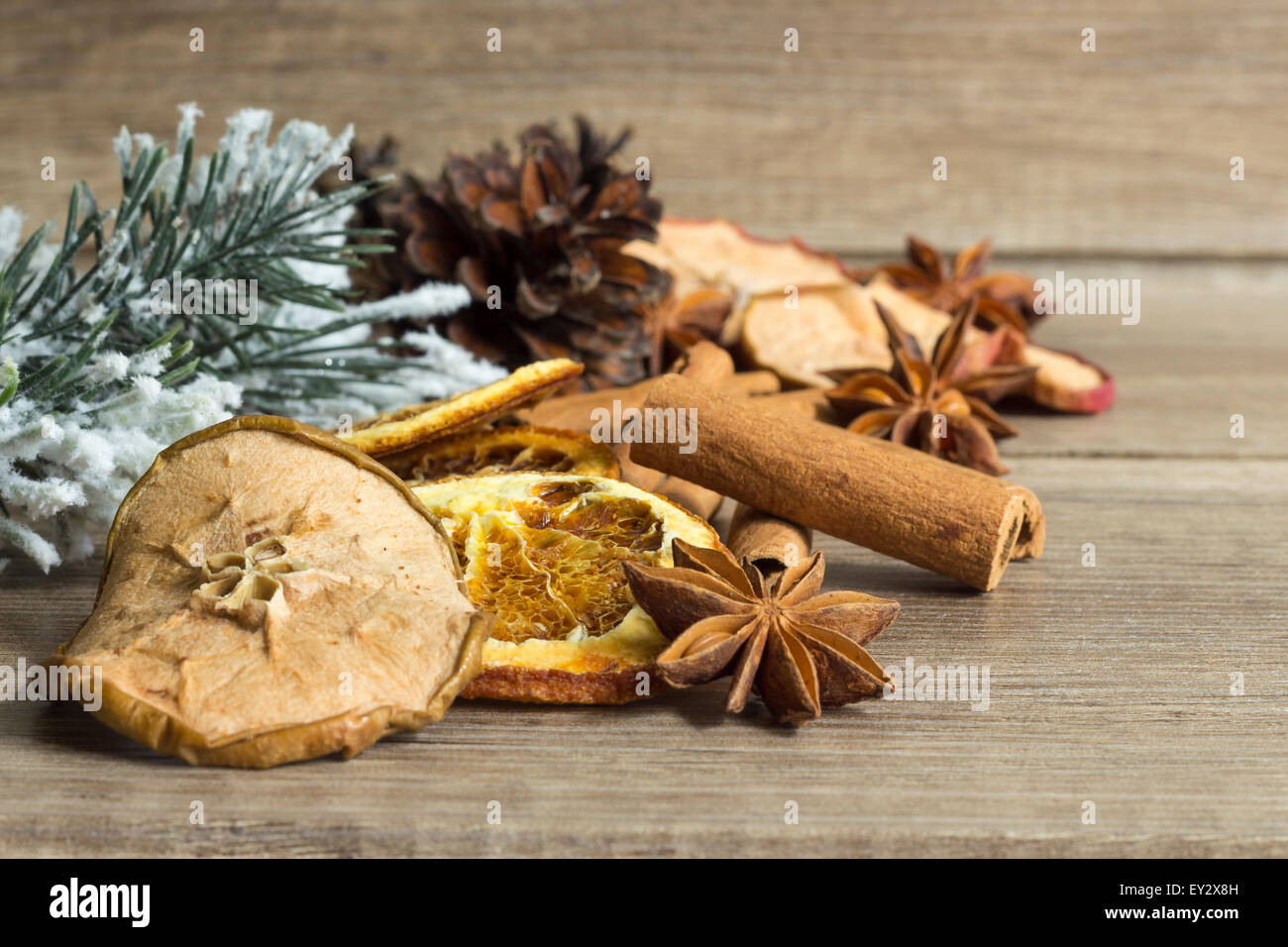 Dried fruits and spices on wooden planks, Christmas decoration - Stock Image