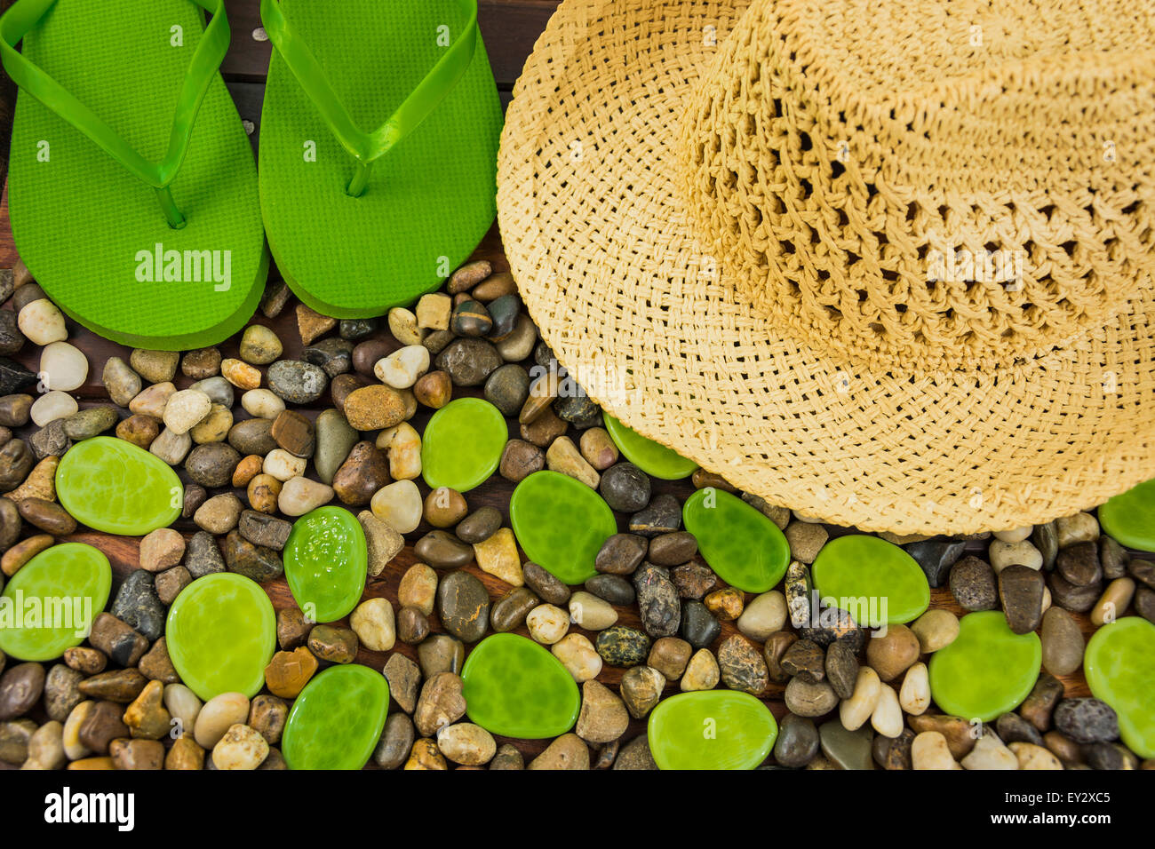 ground gravel pebble with hat and flip flop - Stock Image