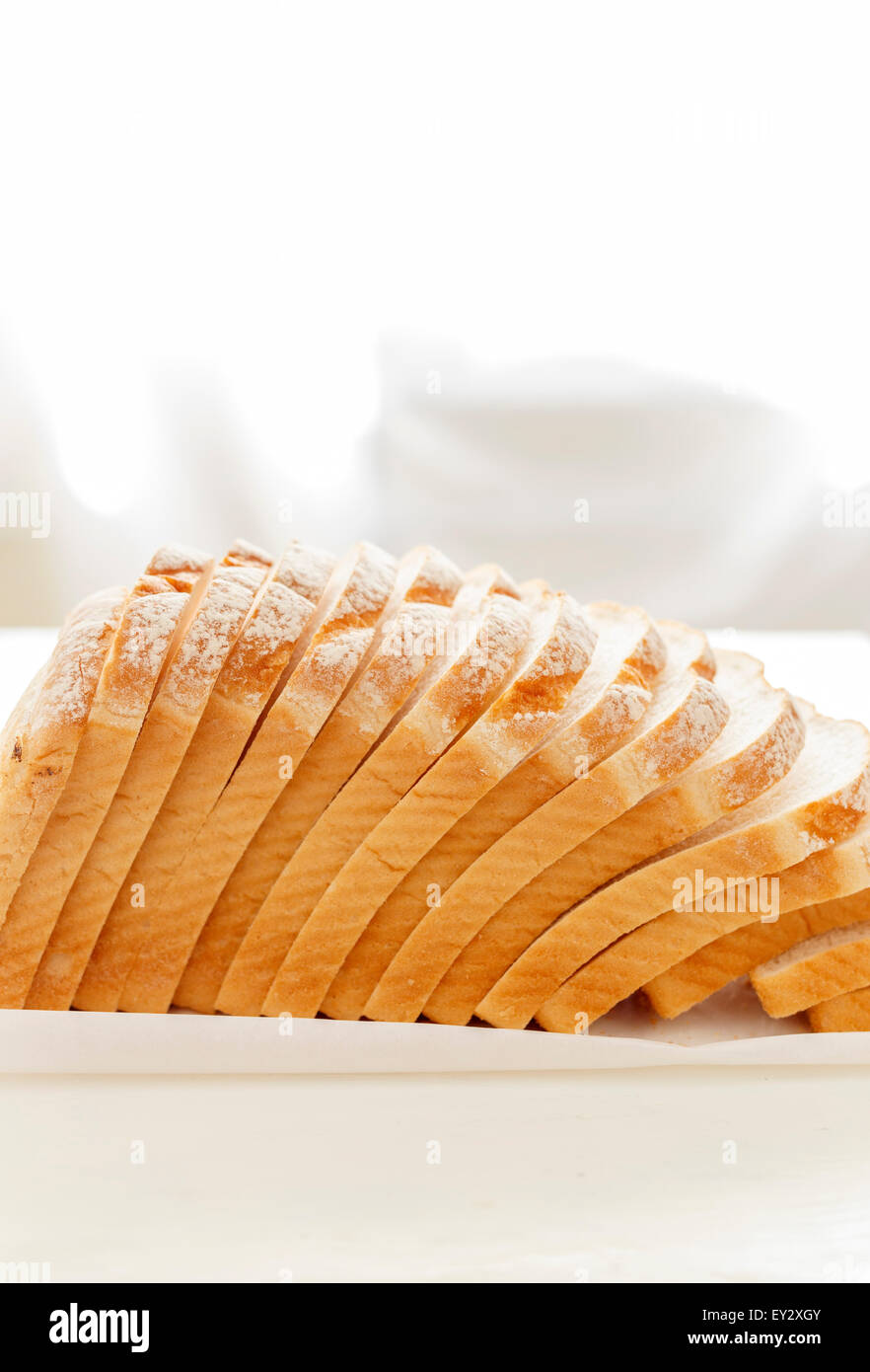 Falling slices of White Bread - Stock Image