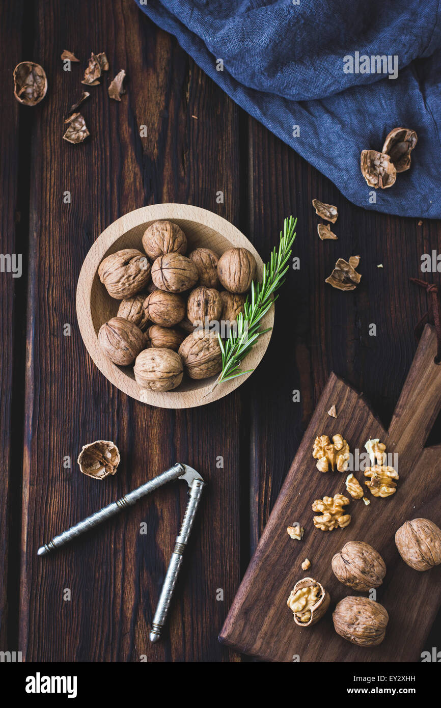 Cracked walnuts on a chopping board. - Stock Image