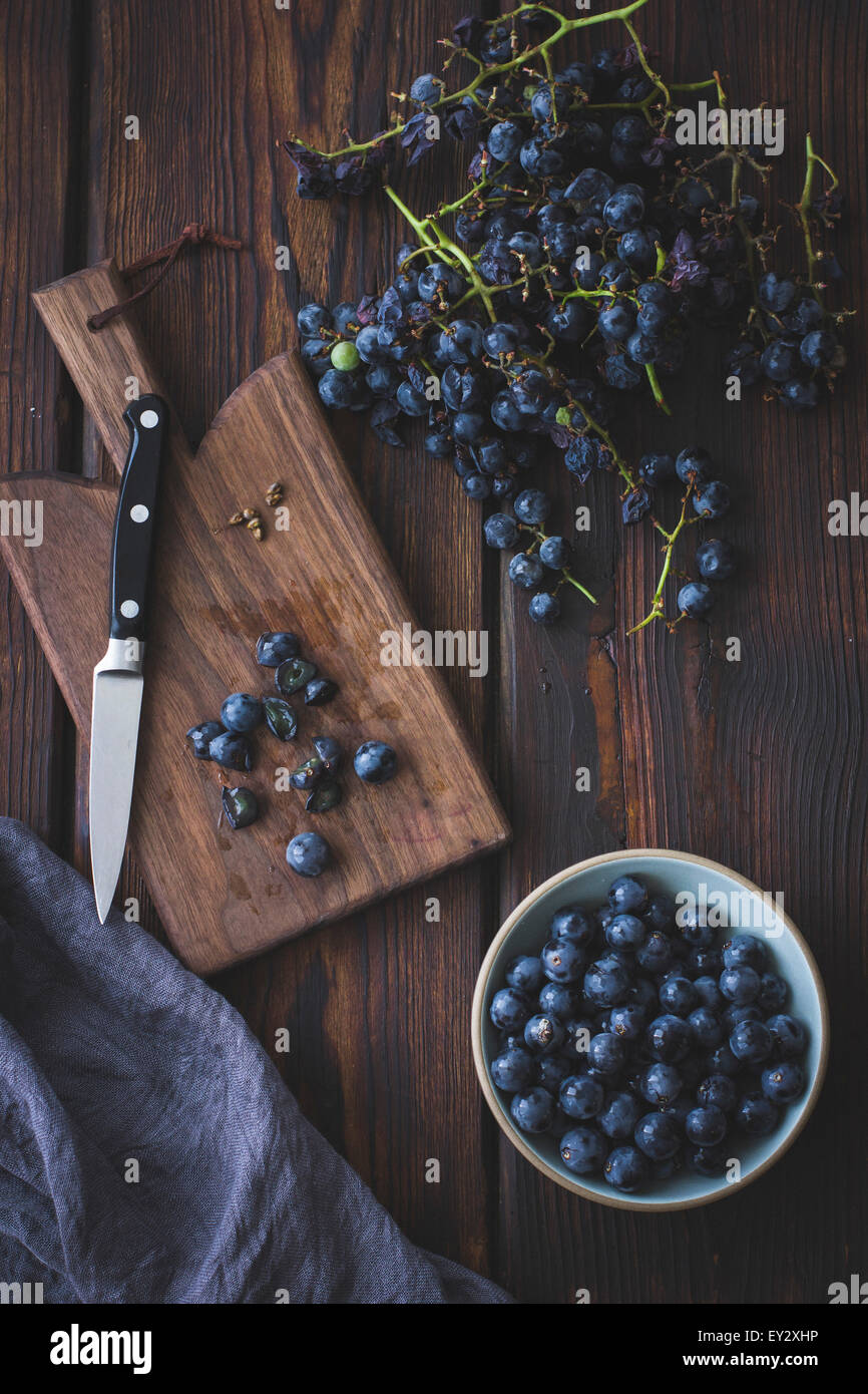 Black grapes on a chopping board Stock Photo