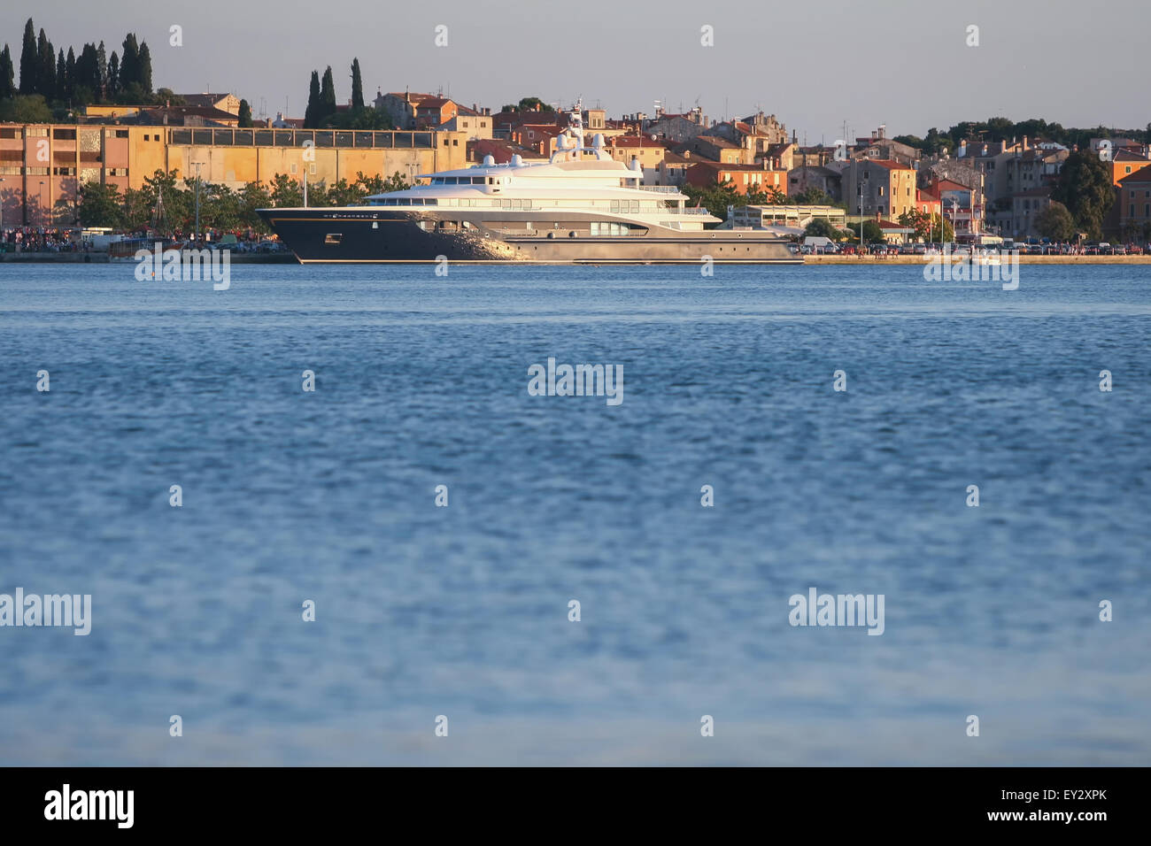 A mega yacht anchored at the dock in Rovinj, Croatia. - Stock Image