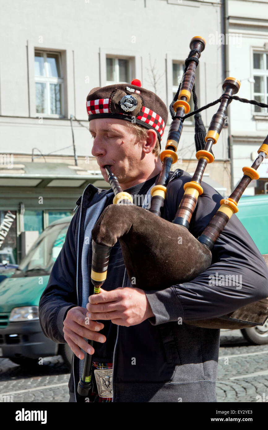 Scotsman on the Streets of Prague, Europe - playing his bag pipe, dressed in kilt.. - Stock Image
