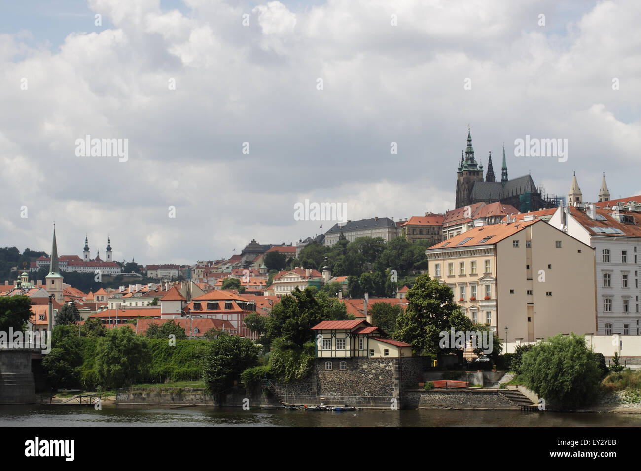 A view across Moldau in Prague, with the view of the Hrdancy Palace in the background - Stock Image