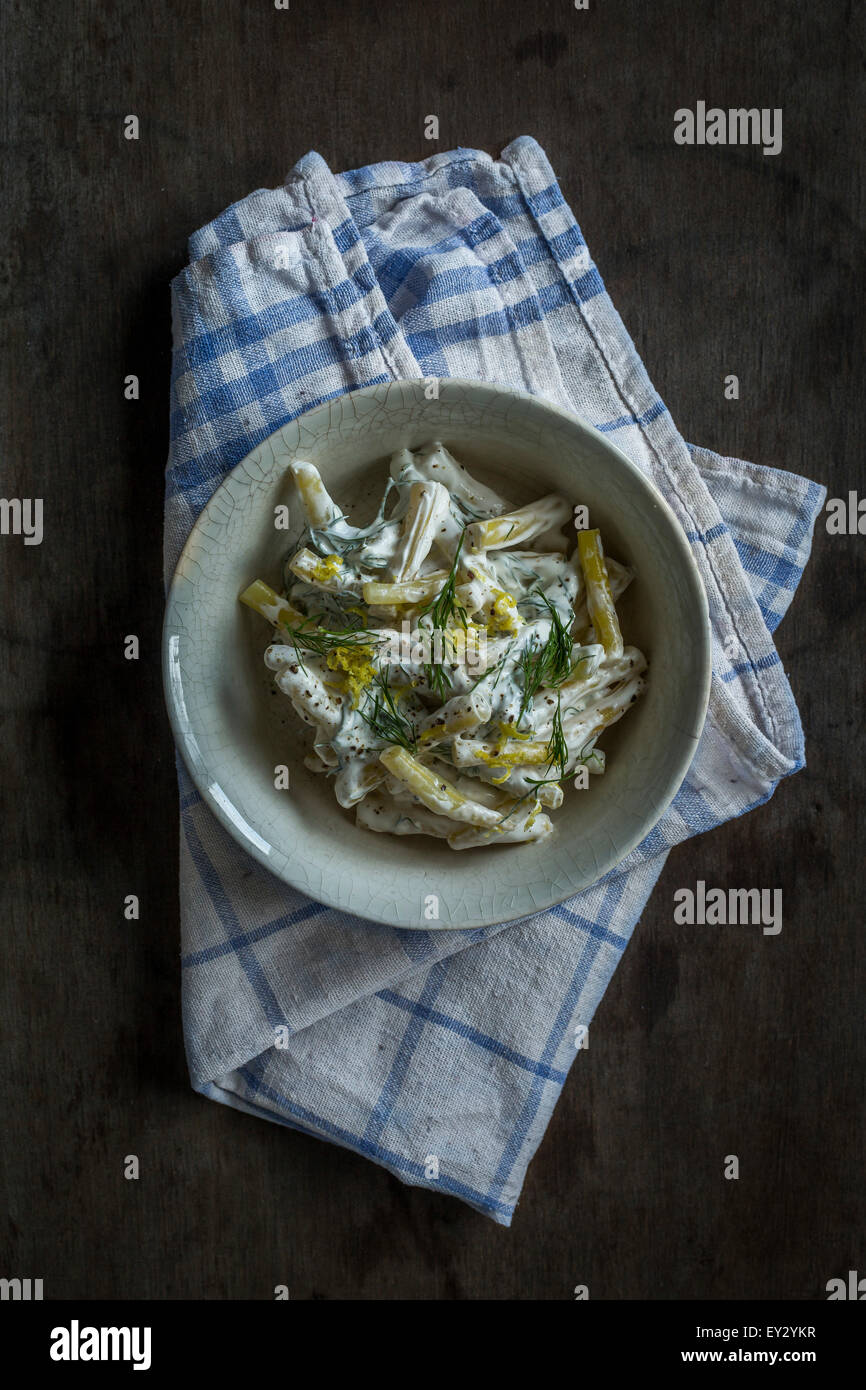 Wax bean salad on wooden background. Top view - Stock Image