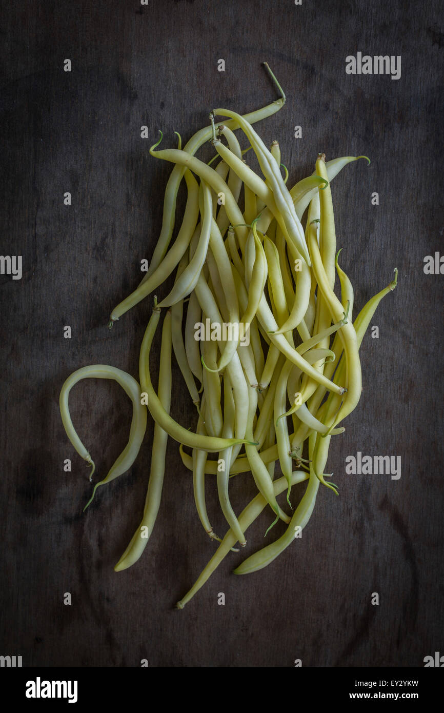 Wax beans on wooden background. Top view - Stock Image