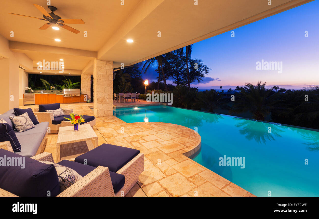 Beautiful Luxury Home with Swimming Pool at Sunset Stock Photo