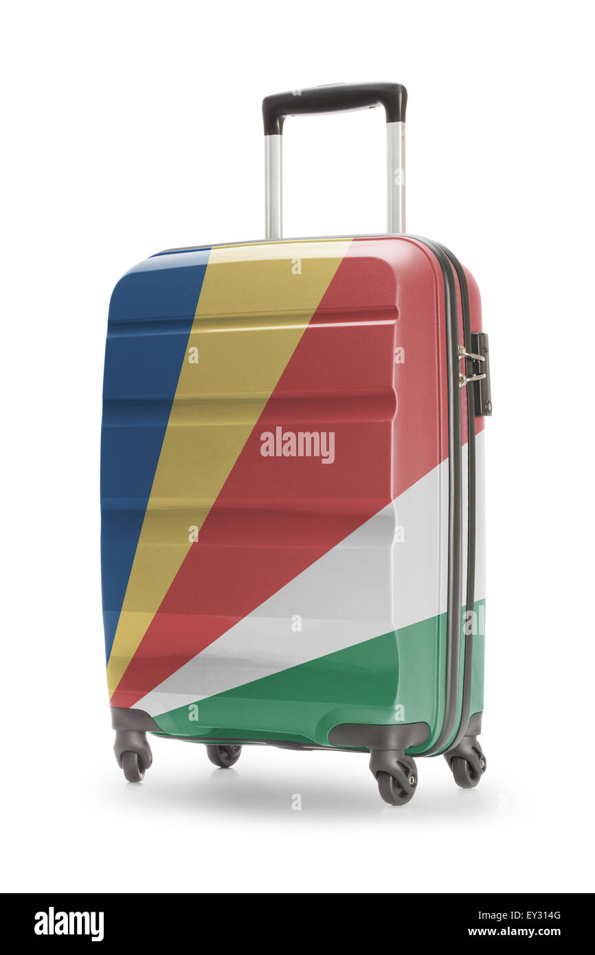 Suitcase painted into national flag - Seychelles - Stock Image