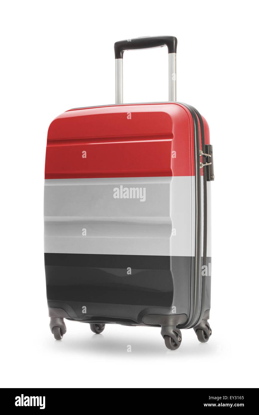 Suitcase painted into national flag - Yemen - Stock Image