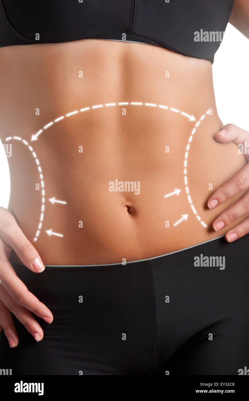 Closeup of a fit woman's abs isolated on a white background Stock Photo