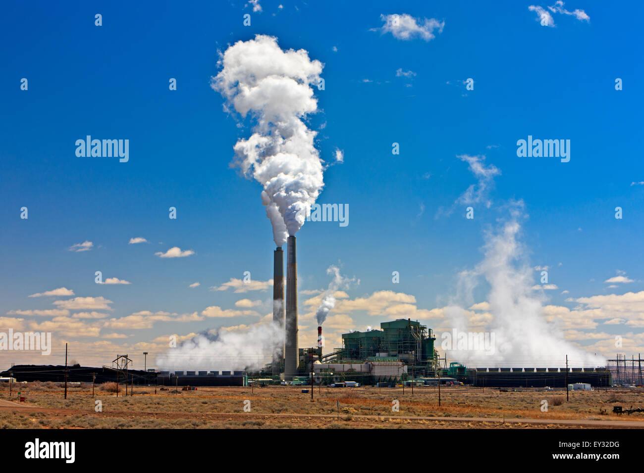 Coal-fired Cholla Power Plant with smoking smokestacks, Arizona, USA - Stock Image