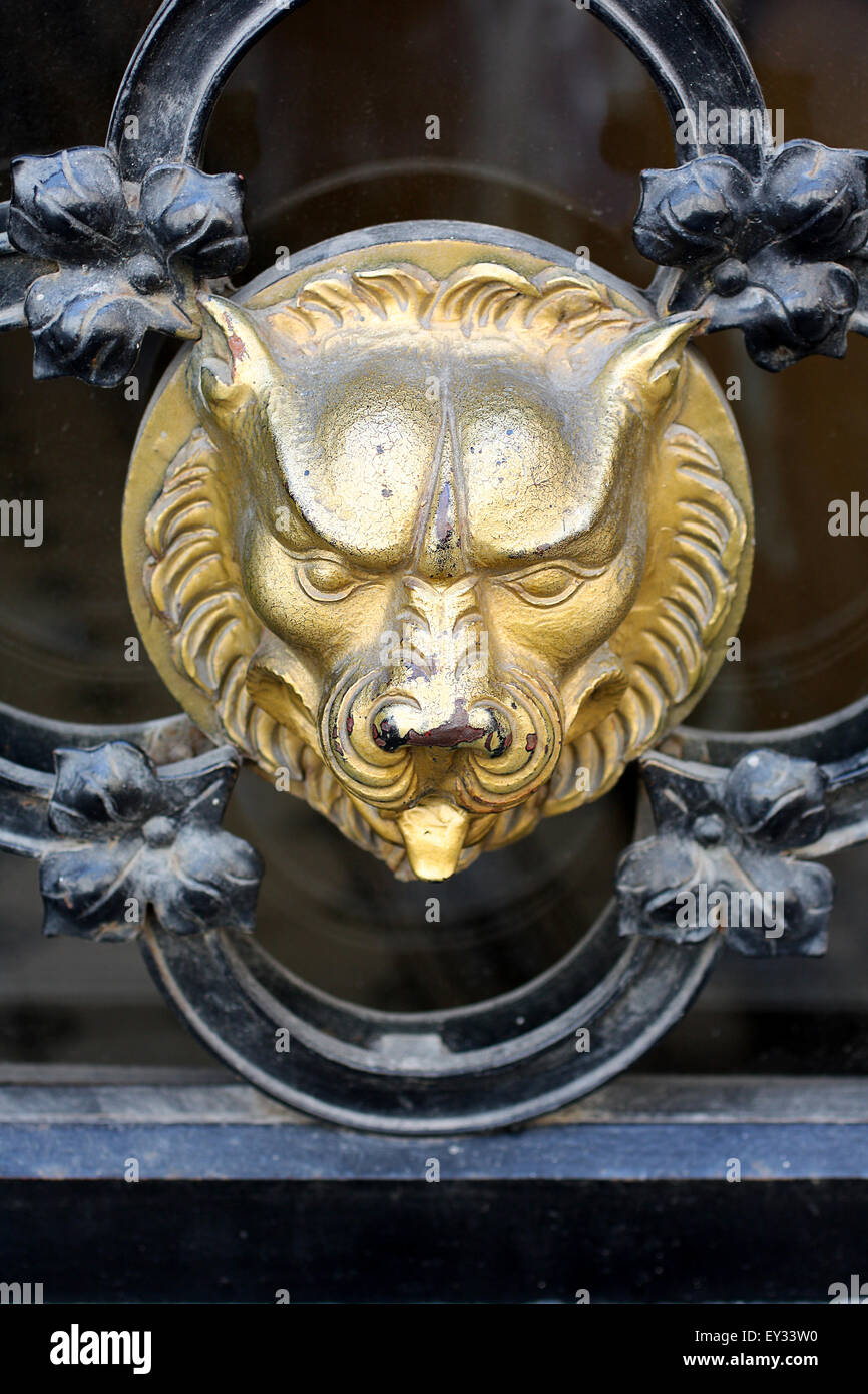 Old golden beast on the medieval gate in Krakow, Poland. - Stock Image