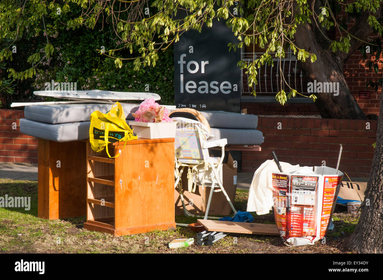 Waste dumped outside a Melbourne apartment block, probably by vacating tenants - Stock Image