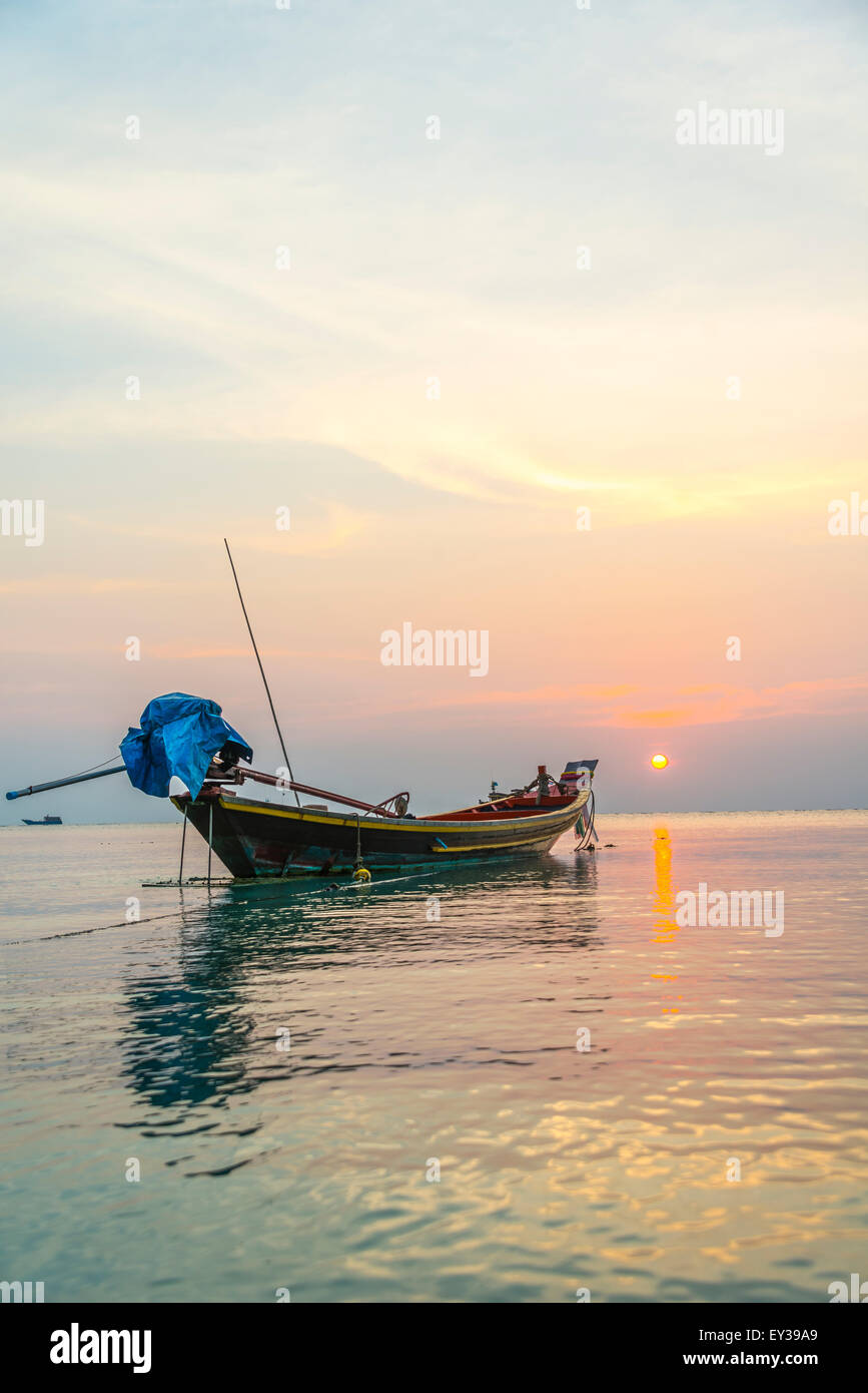 Longtail boat, South China Sea at sunset with boat, Gulf of Thailand, Koh Tao island, Thailand - Stock Image