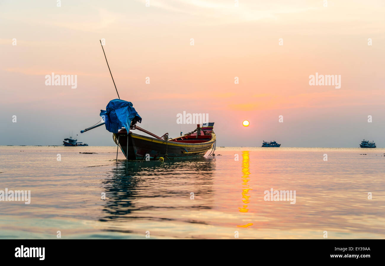 Longtail boat, South China Sea at sunset with boats, Gulf of Thailand, Koh Tao island, Thailand - Stock Image