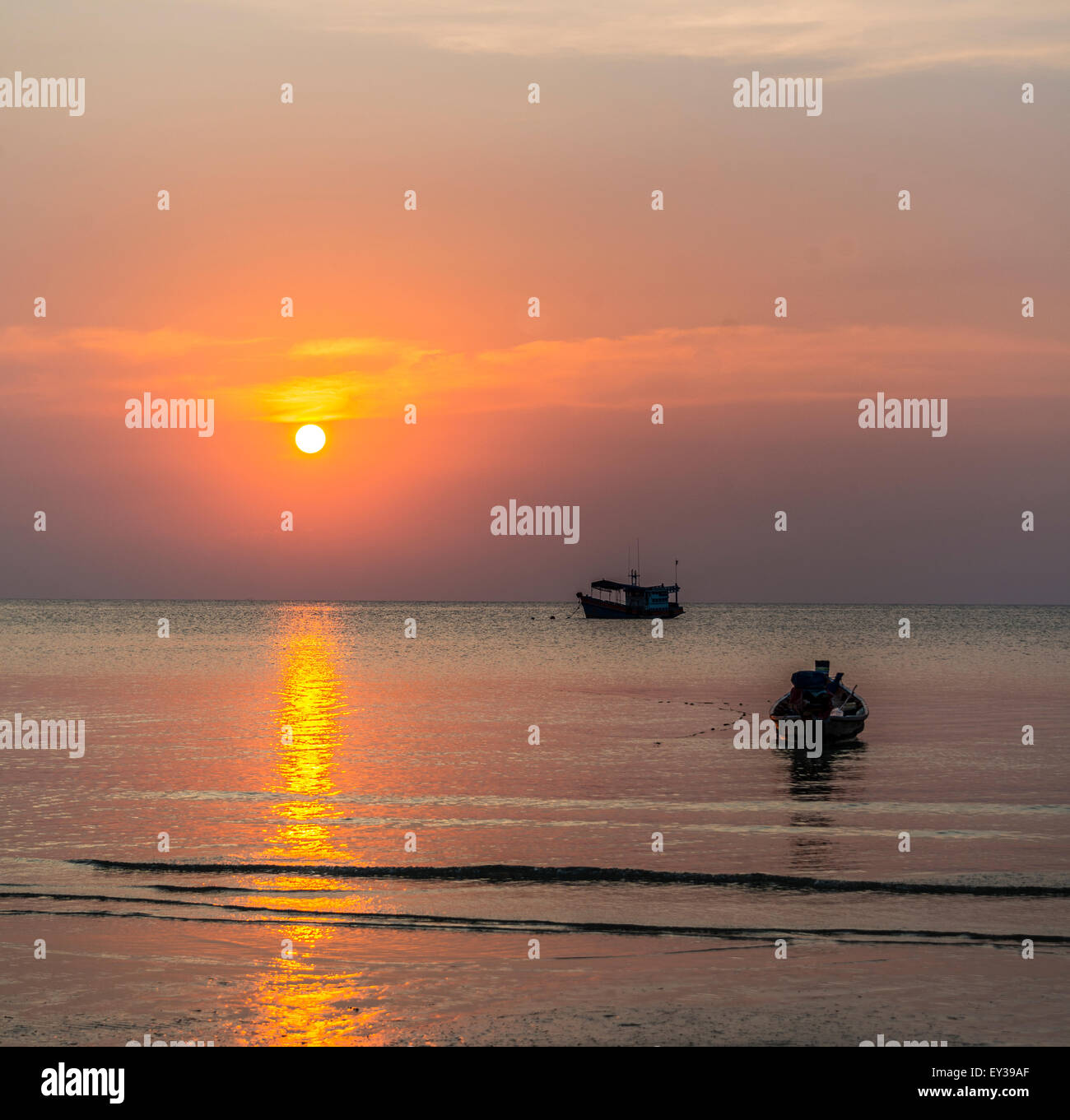 South China Sea at sunset with boats, Gulf of Thailand, Koh Tao island, Thailand Stock Photo