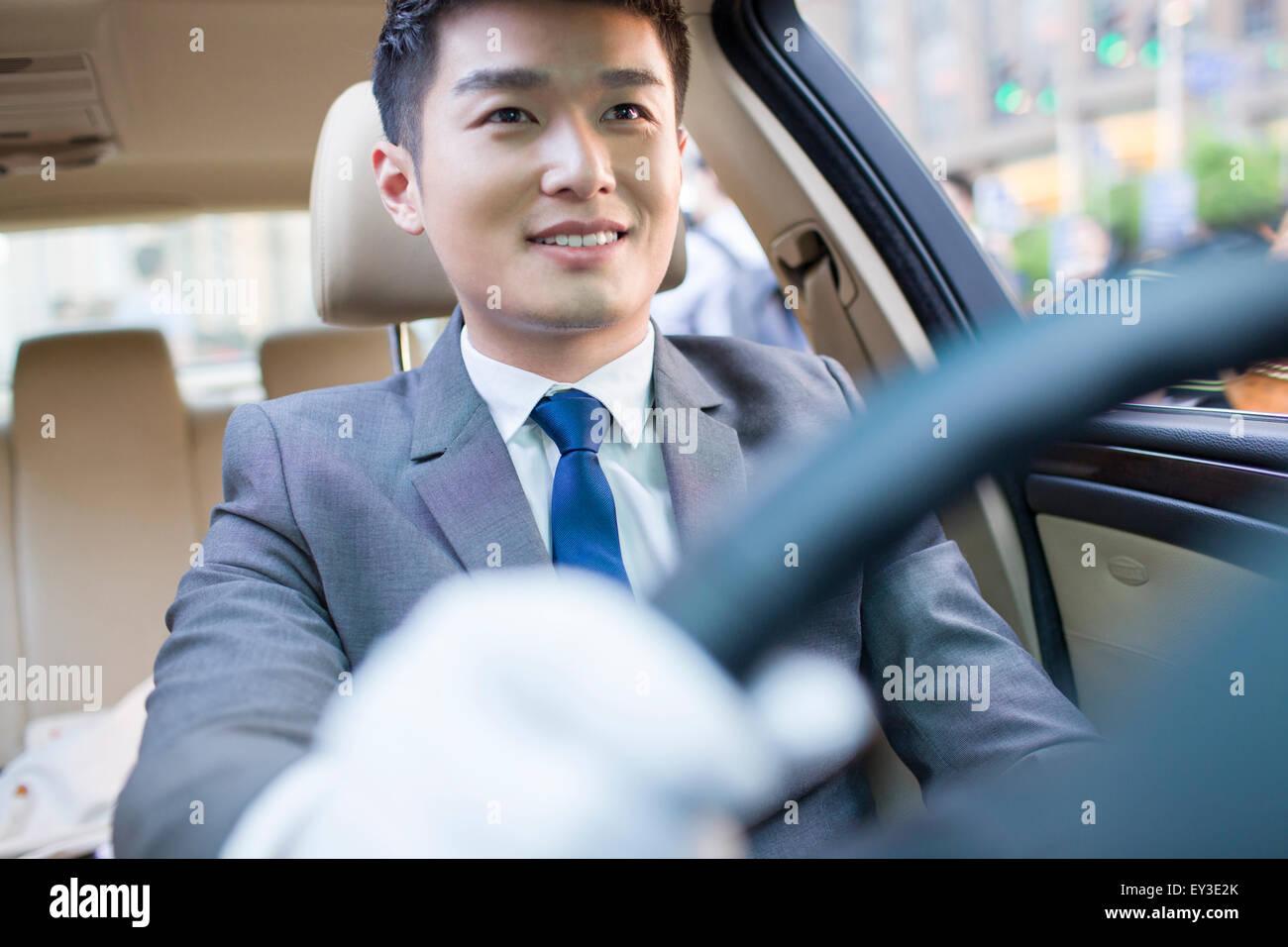 Chauffeur driving car Stock Photo