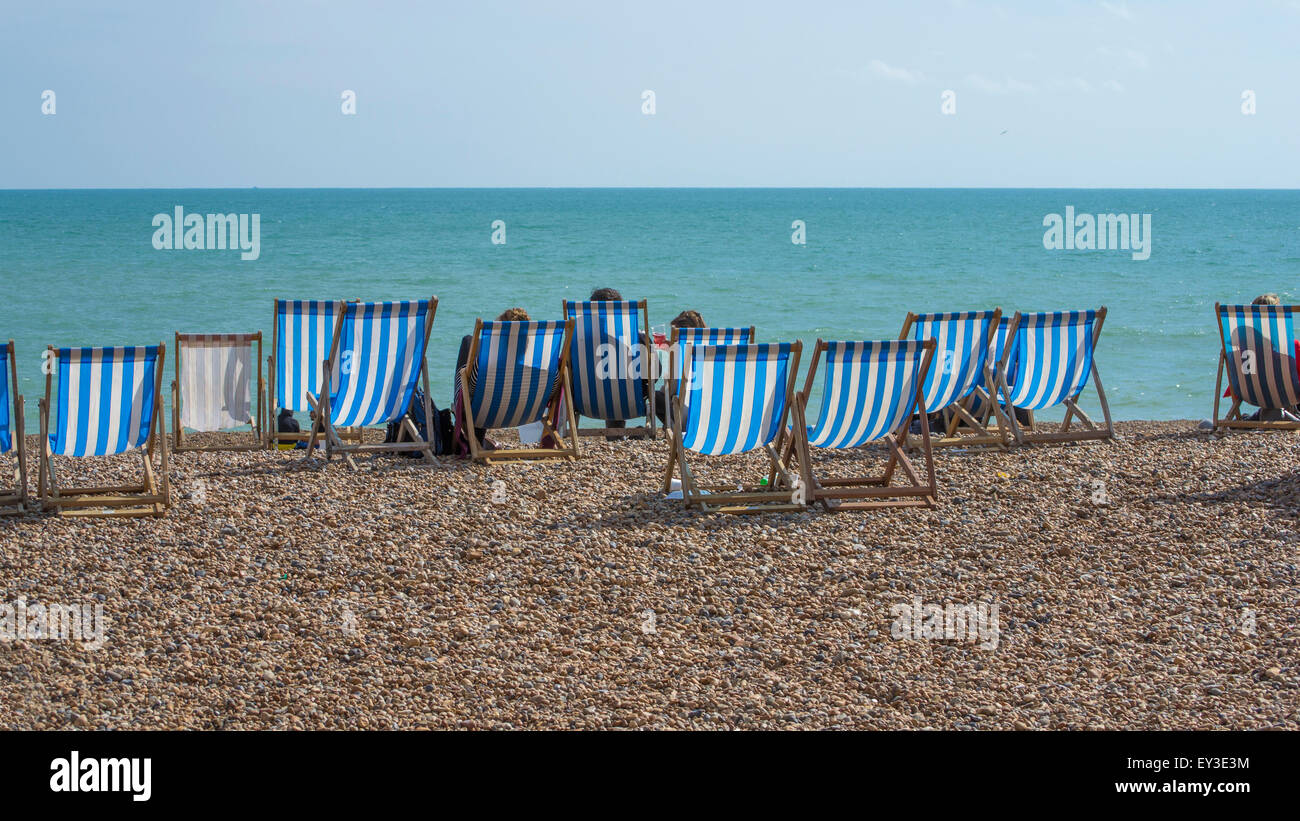 a number of deck-chairs on Bright Beach. Stock Photo