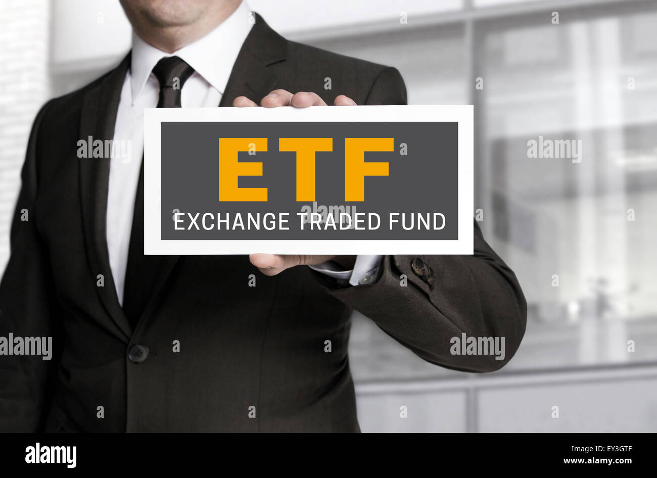 ETF sign is held by businessman background. Stock Photo