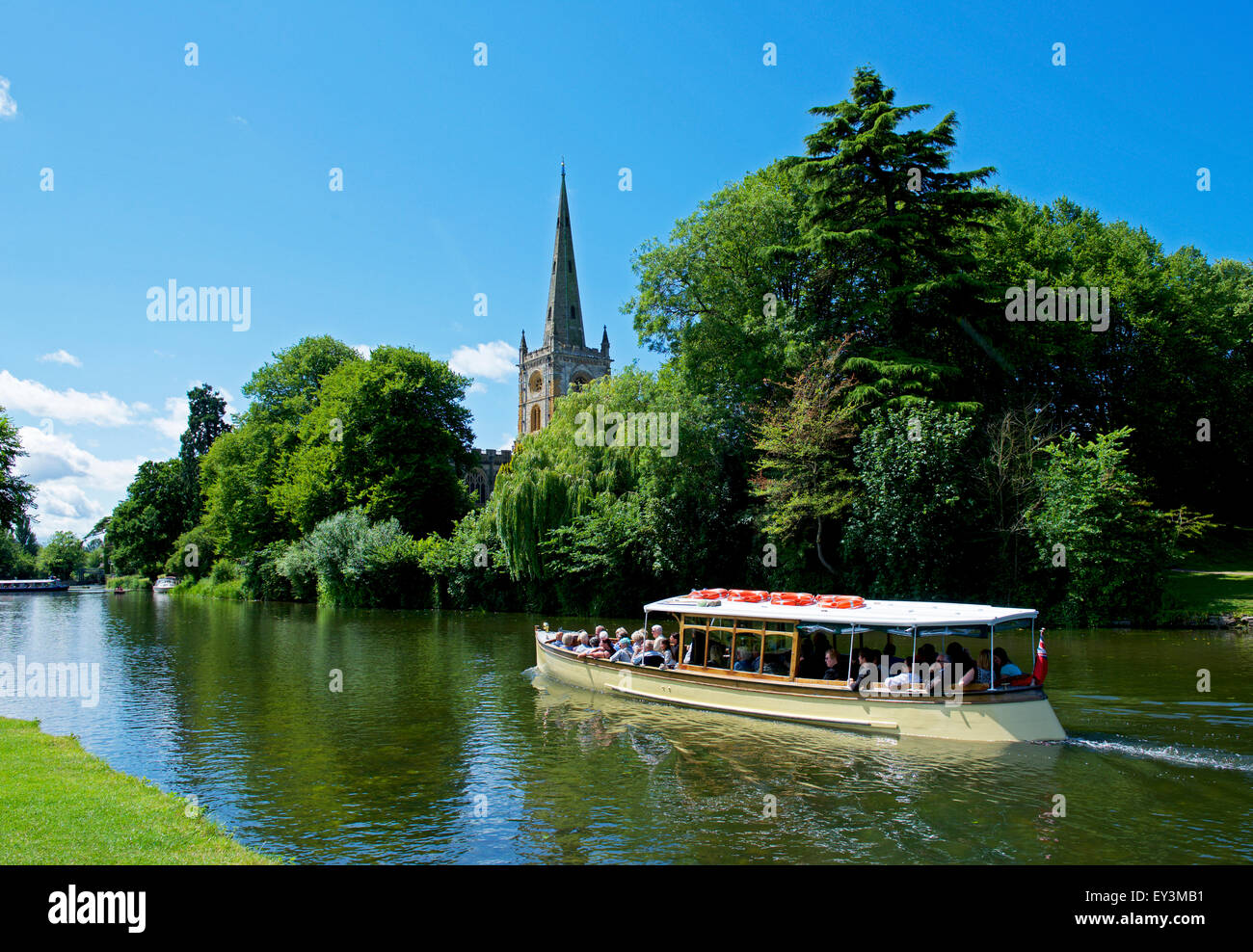 Passenger launch on the River Avon, and Holy Trinity Church, Stratford-upon-Avon, Warwickshire, England UK - Stock Image