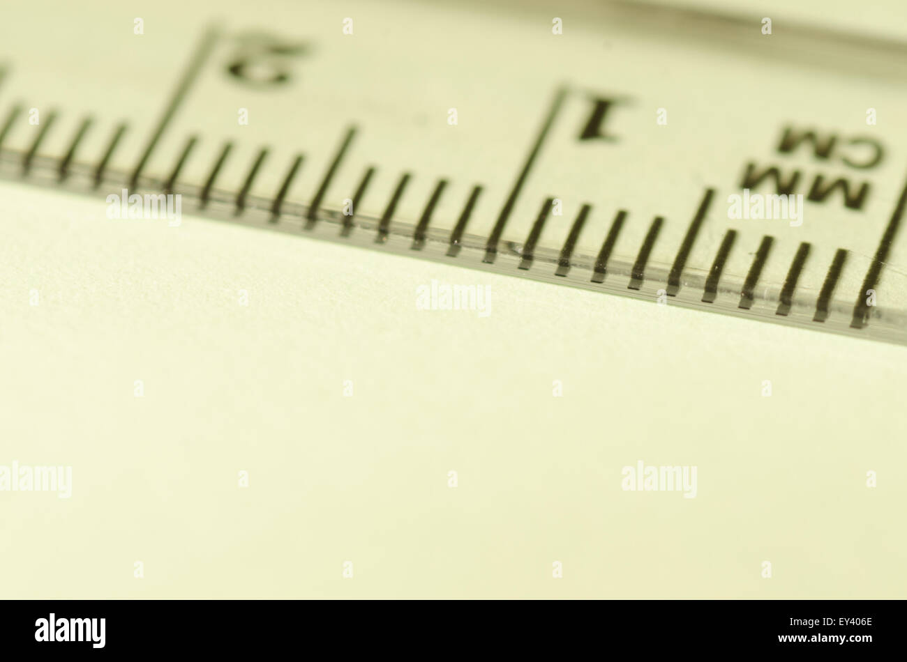 transparent ruler macro on paper background - Stock Image