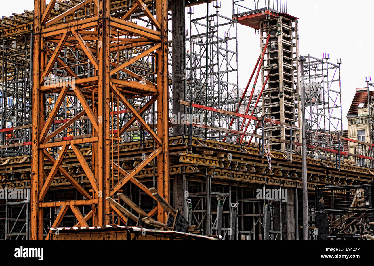 construction site with cranes, scaffolding and all sorts of equipment necessary for building a new house. - Stock Image