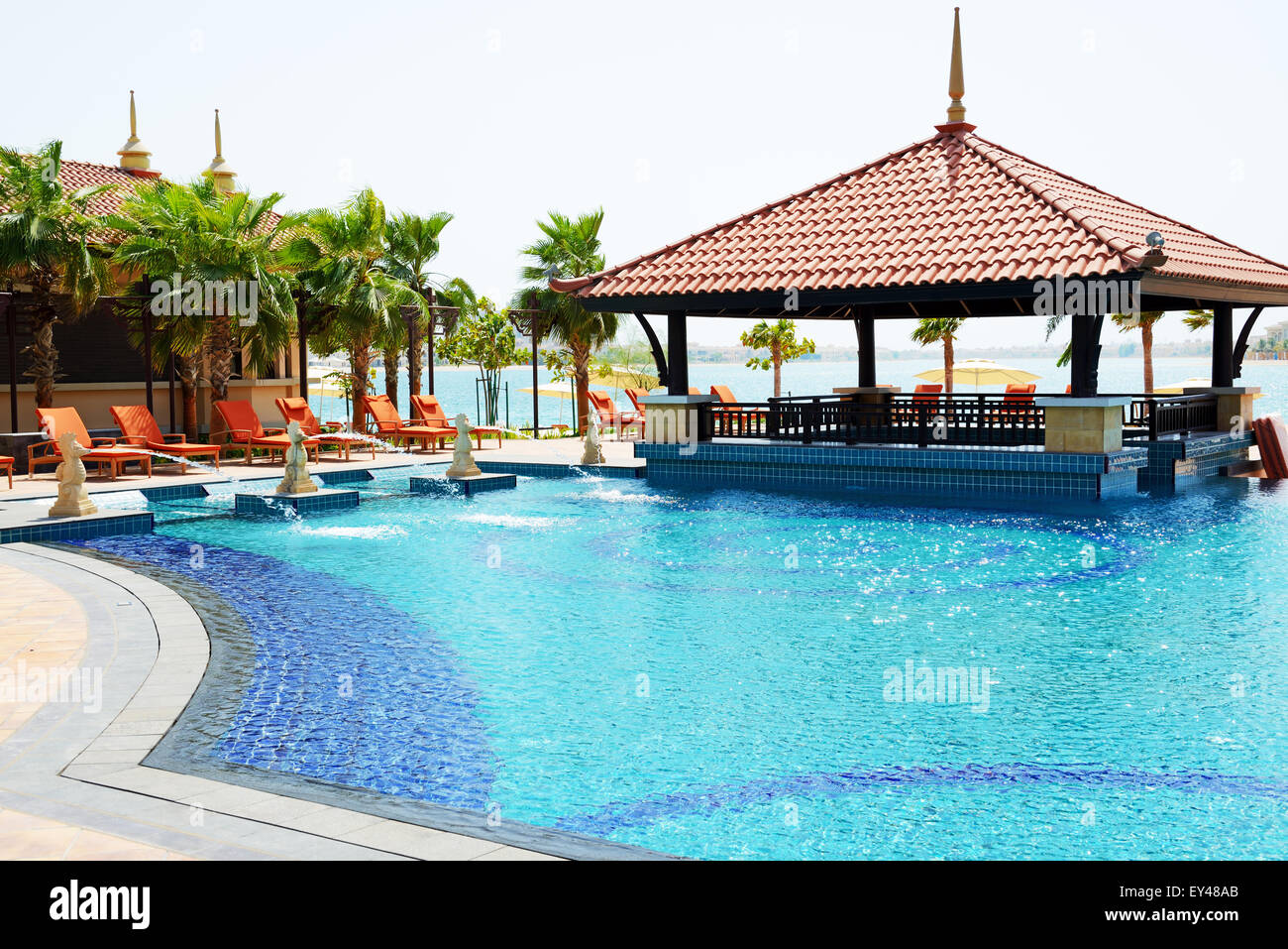 The swimming pool and bar are near beach in Thai style hotel ...