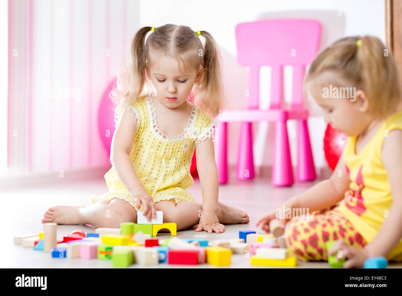 Kids playing in the children room - Stock Image