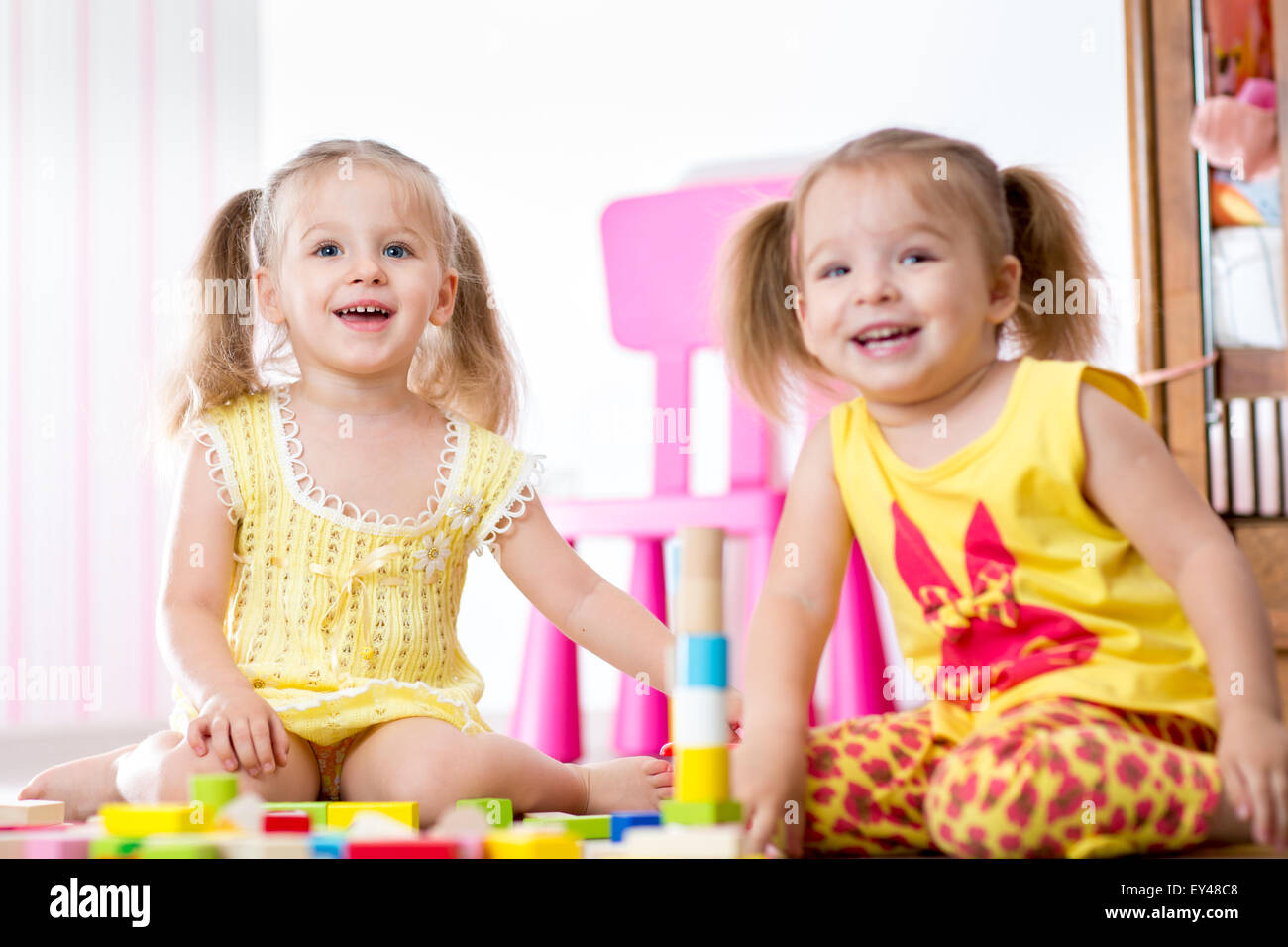 Kids playing with wooden blocks - Stock Image