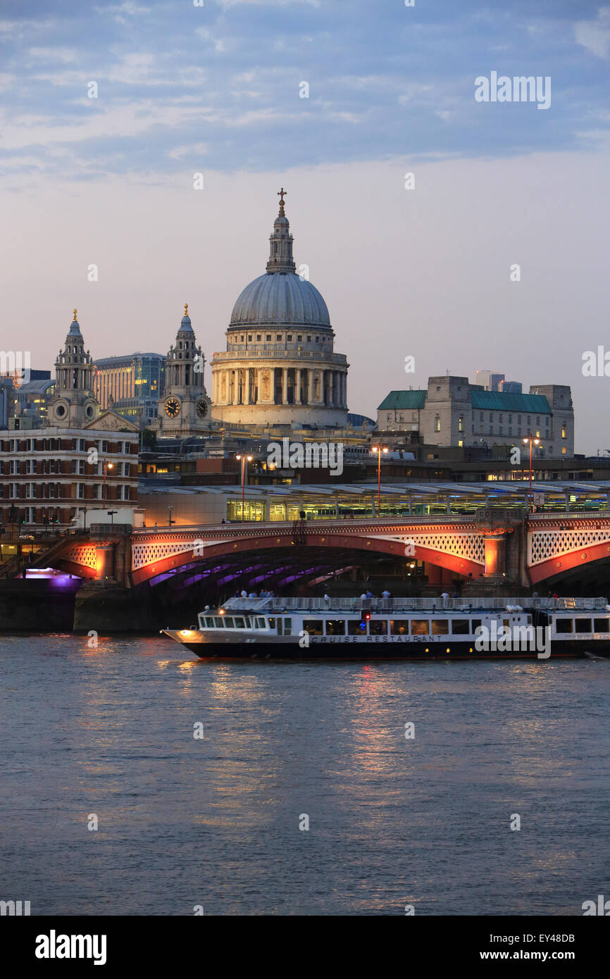 Blackfriars Railway Bridge, in front of St Paul's Cathedral, across the River Thames, at dusk, in London, UK Stock Photo
