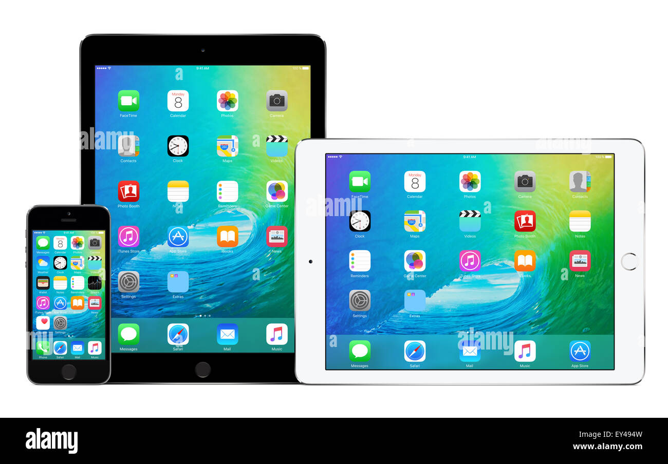 Apple iPhone 5s and two Apple iPad Air 2 in portrait and landscape orientation with announced on WWDC 2015 iOS 9 - Stock Image