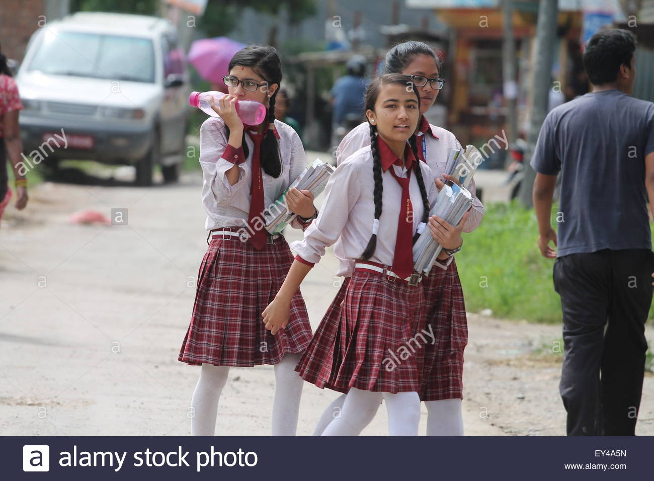 Bhaktapur, Nepal. July 20th, 2015. NEPAL, Bhaktapur:  Young girls holding their schoolbooks at Candid International - Stock Image