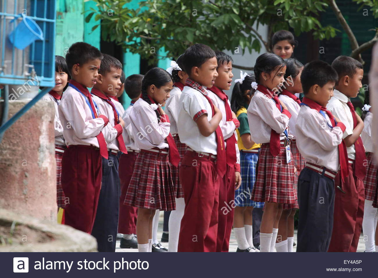 Bhaktapur, Nepal. July 20th, 2015. NEPAL, Bhaktapur:  Young children say morning prayer at Candid International - Stock Image
