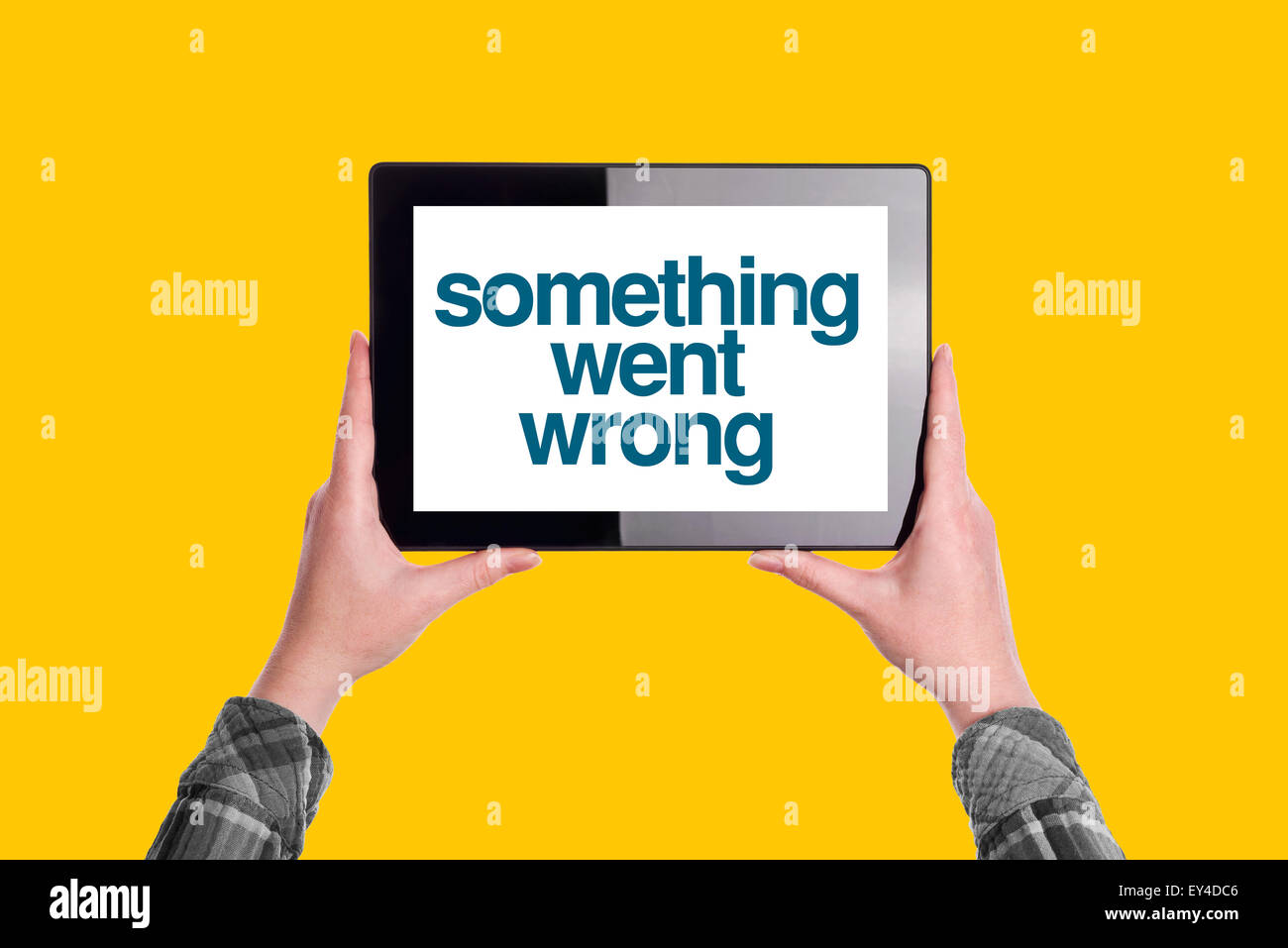 Something Went Wrong Message on Digital Tablet Computer Display, Woman Holding Device, Isolated on Yellow Background - Stock Image