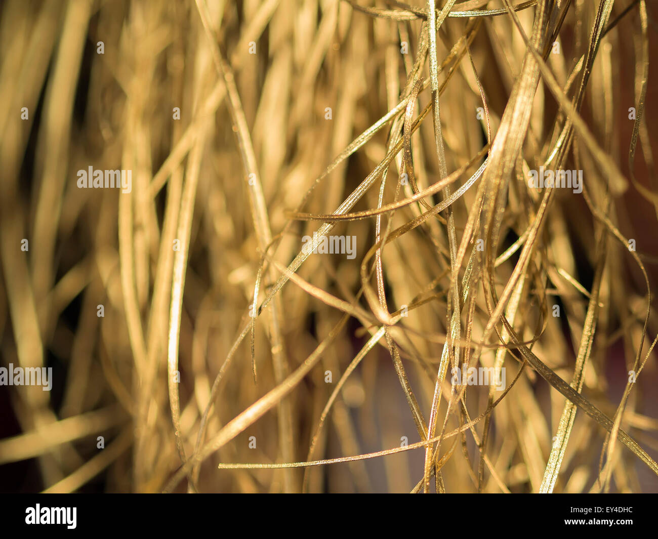 Image of synthetic golden straw on a Christmans Market - Stock Image