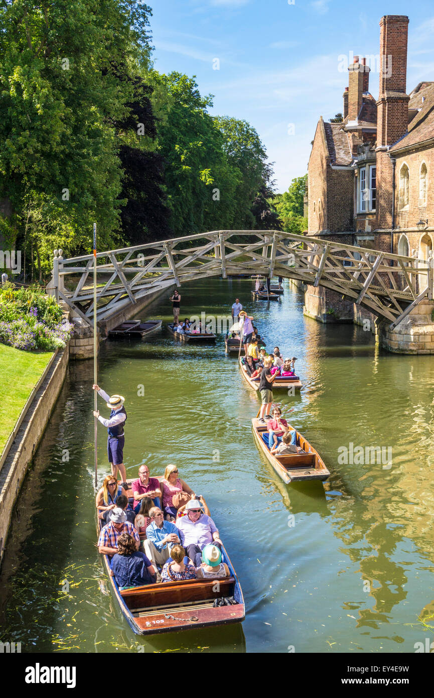 Tourists punting by the Mathematical Bridge at Queens College Cambridge University Cambridgeshire England UK GB - Stock Image