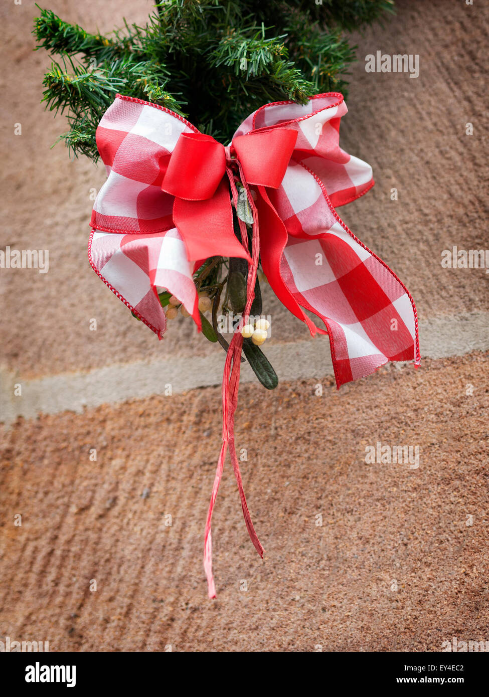Image of a red white bow of ribbon as decoration on a Christmas market Stock Photo