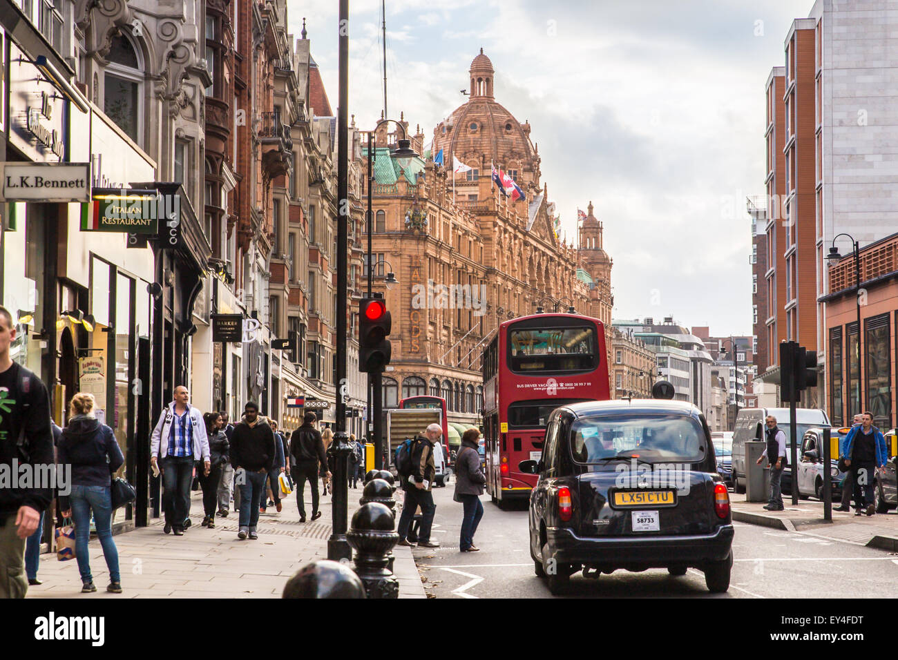 London, United Kingdom - October 8, 2014:  Street view of London along busy Brompton Road in London with Harrods - Stock Image