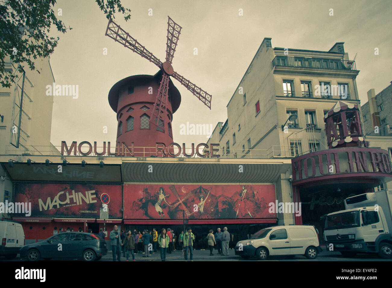 Paris, France - October 9, 2014:  Street view with cars and people in at historic Moulin Rouge Paris France with - Stock Image