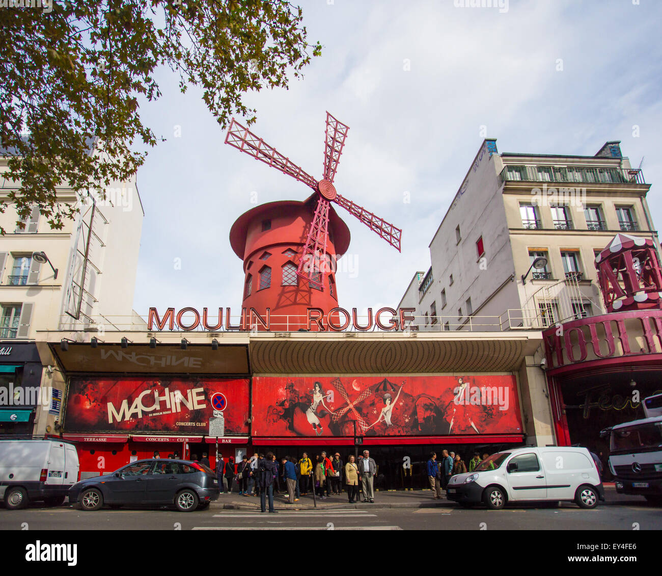 Paris, France - October 9, 2014: Street view of historic Moulin Rouge in Paris France with people and cars visible. - Stock Image
